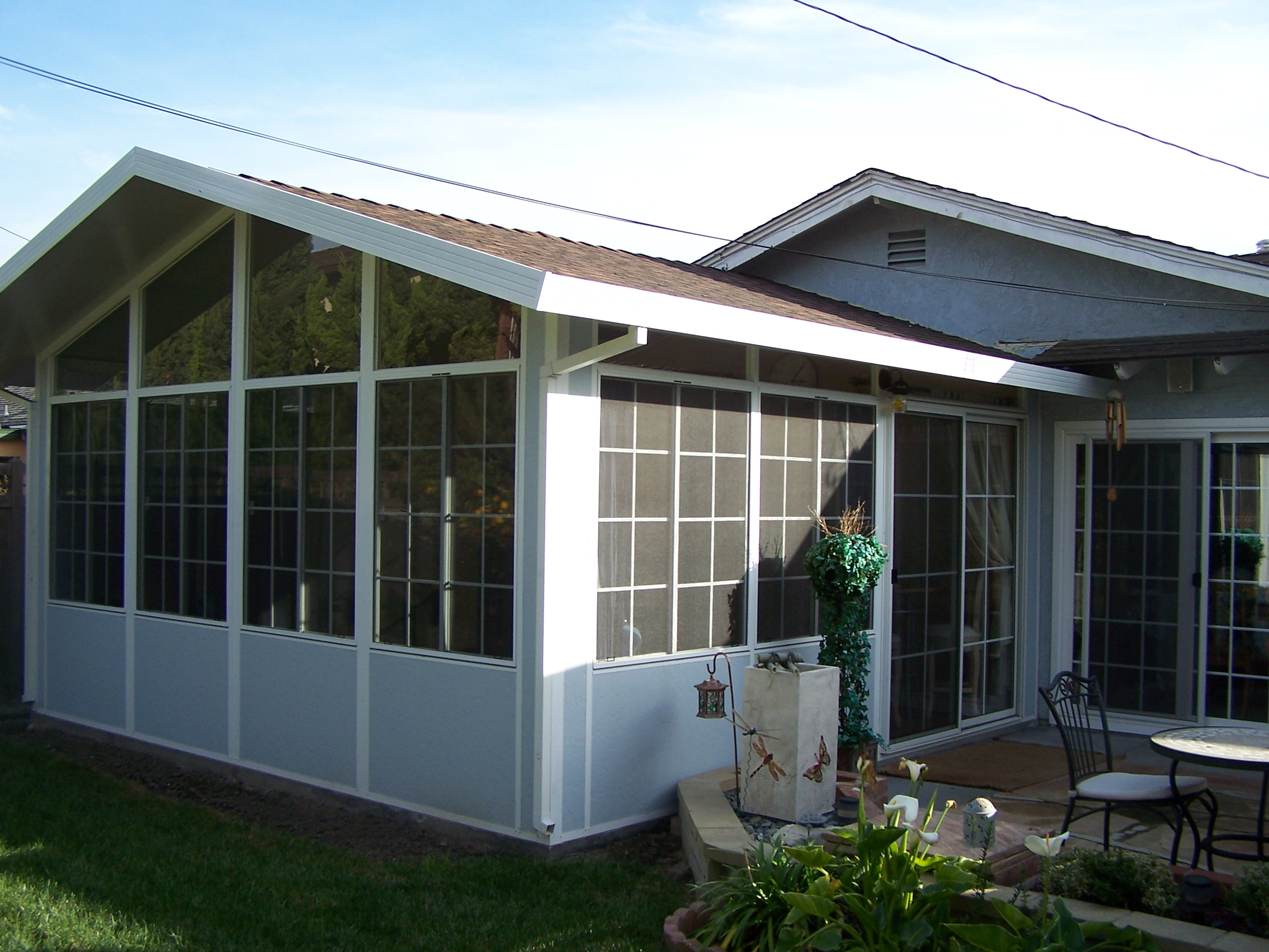 Enclosed sunrooms ocean pacific patios for Backyard sunroom